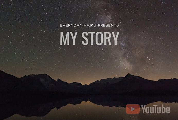 "A starry night sky with black mountains reflecting on a darkened lake. Haiku Meditative Videos ""My Story"""