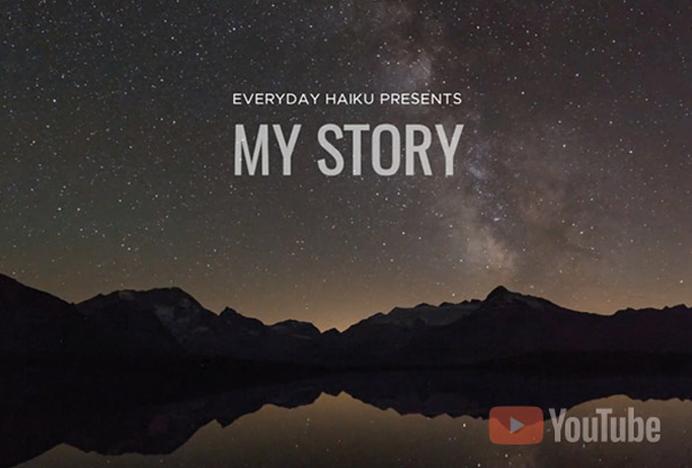 "A starry night sky with black mountains reflecting on a darkened lake. Haiku Meditative Videos ""My Story"""